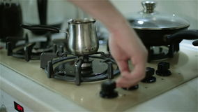 Switching on the cooker to make coffee. stock footage