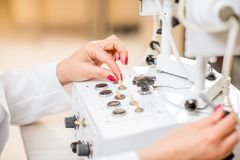 Switching with finger hardware for vision checking. In the ophthalmologist office Stock Images