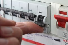 Switching an MCB & x28;Micro Circuit Breaker& x29; on a UK domestic electr. Switching an MCB Micro Circuit Breaker on a UK domestic electrical consumer unit or Royalty Free Stock Image