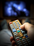 Switching TV channels. Remote control stock photo