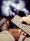 Switching TV channels Royalty Free Stock Photo
