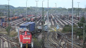 Switchyard Maschen. Overlooking a large switchyard with countless rows of tracks as a freight train gets sorted into different tracks stock video footage