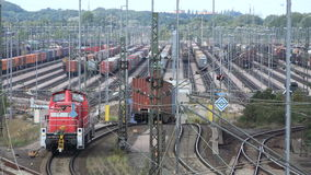 Switchyard Maschen. Overlooking a large switchyard with countless rows of tracks as a freight train gets sorted into different tracks stock footage