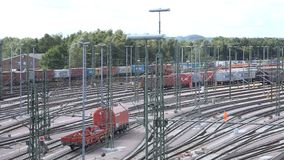 Switchyard Maschen. Overlooking a large switchyard with countless rows of tracks as a freight train rolls by stock footage