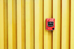 Swith do alarme de incêndio no fundo de madeira Fotografia de Stock Royalty Free