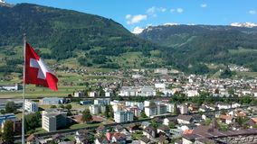 Swittzerland small willage aerial shot and flag. Aerial shot stock footage
