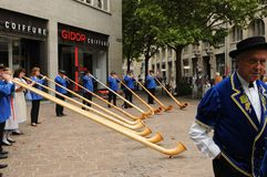Alphorn musicians at the swiss national day playing in Zürich-City. Switzerland: Alphorn musicians at the swiss national day playing in Zürich City near royalty free stock photo