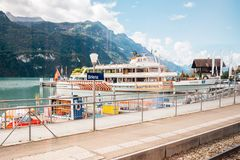 Brienz lake and cruise ship at Brienz railway station in Switzerland stock photography