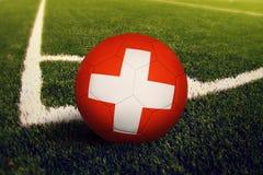 Switzerland ball on corner kick position, soccer field background. National football theme on green grass.  vector illustration