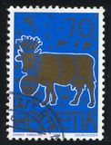 Golden Cow. SWITZERLAND - CIRCA 1996: stamp printed by Switzerland, shows Stamp Design Competition Winner: Golden Cow, circa 1996 royalty free stock images