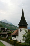Switzerland. Clock tower of rural church in Leissigen, Switzerland Royalty Free Stock Photos