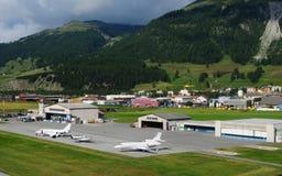 Switzerland: Europe`s highest airport is in Samedan in the upper. Switzerland: Airplanes, private-jets and helicopters at Europe`s highest airport is in Samedan stock photo