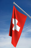 Switzerland Flag. The Switzerland flag on a blue sky with clipping path stock illustration