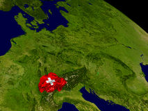Switzerland with flag on Earth Royalty Free Stock Photography