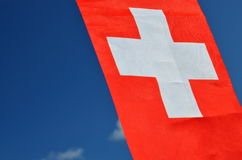 Switzerland flag with fabric structure against blue sky Royalty Free Stock Photography