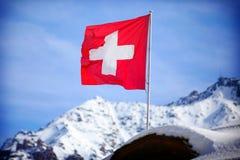Switzerland flag Over Swiss Mountains Royalty Free Stock Photo