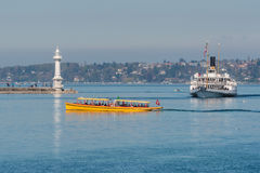 Switzerland Geneva company of traditional boats runs a lake navigation. Boat that crosses the lake in geneva since 1897 The boats are painted in the colors of royalty free stock photography