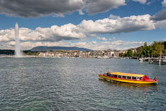 Switzerland Geneva company of traditional boats runs a lake navigation. Boat that crosses the lake in geneva since 1897 The boats are painted in the colors of stock photo