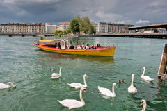 Switzerland Geneva company of traditional runs a lake navigation. Boat that crosses the lake in Geneva since 1897 The boats are painted in the colors of the city stock photo