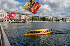 Switzerland Geneva company of traditional runs a lake navigation. Boat that crosses the lake in Geneva since 1897 The boats are painted in the colors of the city royalty free stock photos