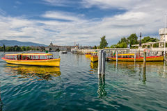 Switzerland Geneva company of traditional runs a lake navigation. Boat that crosses the lake in Geneva since 1897 The boats are painted in the colors of the city stock image