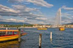 Switzerland Geneva company of traditional runs a lake navigation. Boat that crosses the lake in Geneva since 1897 The boats are painted in the colors of the city stock photography