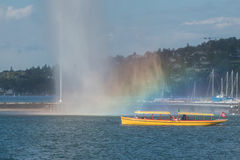 Switzerland Geneva company of traditional runs a lake navigation. Boat that crosses the lake in Geneva since 1897 The boats are painted in the colors of the city stock images