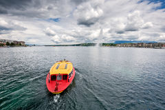 Switzerland Geneva company of traditional runs a lake navigation. Boat that crosses the lake in Geneva since 1897 The boats are painted in the colors of the city royalty free stock image