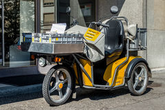 Switzerland, Geneva - June 2015. Swiss post delivery motorcycle on the street in the city center of Geneva. Swiss post is a public Royalty Free Stock Photos
