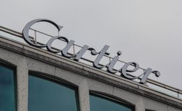 Switzerland; Geneva; March 9, 2018; Cartier sign on a roof of a. Buildingl; Cartier is french jewellery and watchmaker Royalty Free Stock Photography