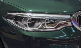 Switzerland; Geneva; March 8, 2018; The close up of BMW Adaptive. LED headlight; The 88th International Motor Show in Geneva from 8th to 18th of March, 2018 royalty free stock image