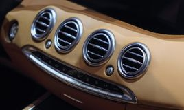 Switzerland; Geneva; March 8, 2018; A macro close up view of Mercedes-Benz air vents on the dashboard; the 88th International royalty free stock image