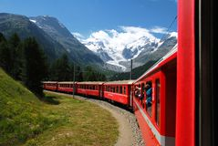 The Bernina Express train of the Rhaetian Railway, with the Morteratsch glacier in the background, Switzer stock photography