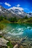 Switzerland,Lac Bleu, Lake with the mountains view. Royalty Free Stock Photo