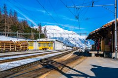 Switzerland landscape of snow mountain at the railway station. In the morning stock images