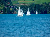 Switzerland, Lauterbrunnen, SAILBOAT SAILING ON SEA BY TREES royalty free stock photos