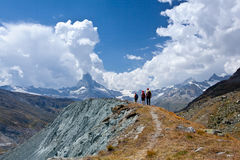 Switzerland - Matterhorn peack, hikers. Great switzerland trip - glaciers, mountains and clouds. people in mountains Stock Photo