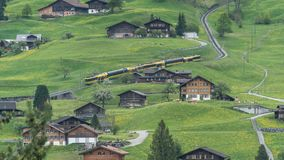 Alpine express rushing through scenic valley in Switzerland Royalty Free Stock Images