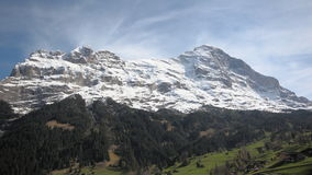 Switzerland, mountains including the North Face. The North face of the Eiger with some greenery Stock Photo