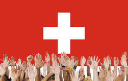 Switzerland National Flag People Hand Raised Concept Royalty Free Stock Images