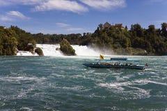 Switzerland,Neuhausen,View of rhine waterfall with tourist boat. Switzerland,Neuhausen,View of rhine waterfall with tourist travelling in boat Stock Photos