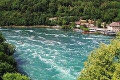 Rheinfall in Switzerland near Schaffhausen. Rheinfall is the bigge. Switzerland. Rheinfall is the biggest waterfall in Europe. Nature baground Stock Photos