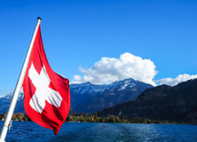 Switzerland`s flag amidst strong wind Royalty Free Stock Image