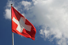 Switzerland's National flag. Blowing in the wind royalty free stock image