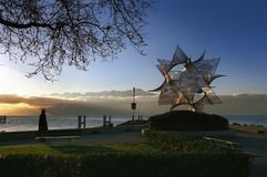 Lake Geneva: Sculpture at Lausanne Ouchy. Switzerland: sculpture in Lausanne-Ouchy at Lake Geneva at sunset in the french speaking part royalty free stock image