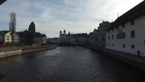 Switzerland, 08.12.2016: the skyline of the medieval city of Lucerne seen from the famous Ponte dei Mulini, Spreuerbrücke, stock video footage