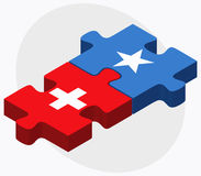 Switzerland and Somalia Flags in puzzle isolated on white background Royalty Free Stock Photography