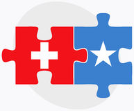 Switzerland and Somalia Flags in puzzle isolated on white background Royalty Free Stock Image