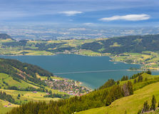 Switzerland: town at mountain lake Stock Photos
