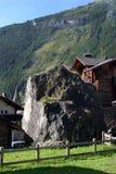 Switzerland, Valais, Evolene village. Switzerland, Valais, Evolene village, house and big stone royalty free stock photos